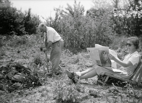 A man working on Sunday morning in his victory garden in Oswego, New York, ca. 1943