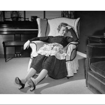 mid-adult-woman-sleeping-on-an-armchair-poster-print-18-x-24_5143633