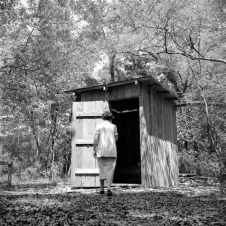 florida-memory-woman-going-into-the-outhouse-in-the-7